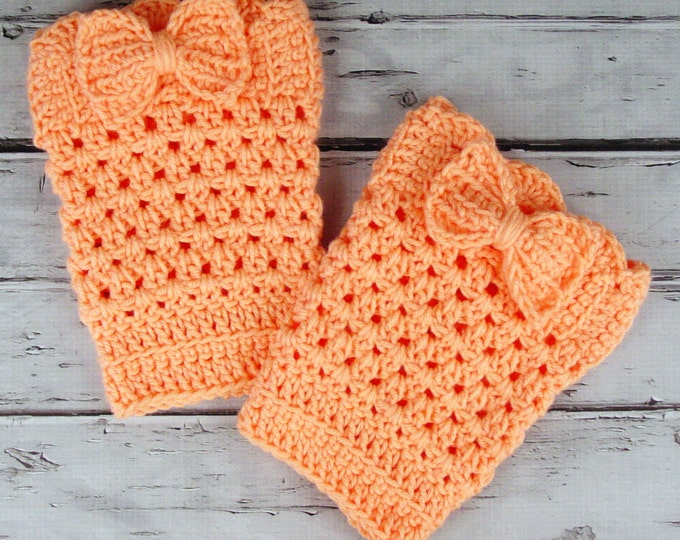 Featured listing image: Lovely Pair of Crocheted Dark Peach Tangerine Boot Cuffs with Bows
