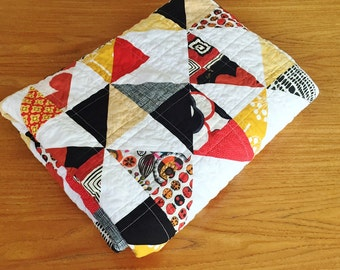 Modern Triangle Quilt in Black, Gold and Red