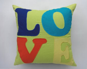 Lime green love  pillow. Decorative nusaery cushion. Lime green with multi color LOVE  embroidery.  22inch euro shame .  On sale 20% off