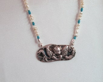 Fine Silver  Cherub non a fresh water pearl necklace