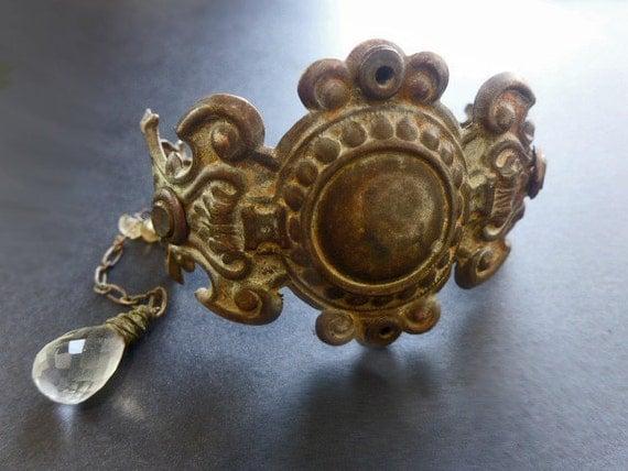 Barakah. Ornate escutcheon cuff bracelet with citrines and aquamarine briolette.