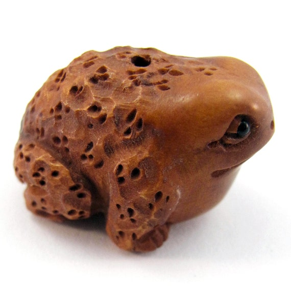 Bull frog hand carved boxwood ojime bead from