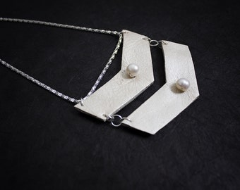 Minimalist geometric leather pendant with a pearls. Necklace. Statement jewelry