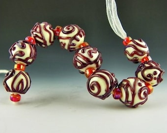 set of 9 round beads in ivory with red/purple stringer designs handmade lampwork glass - Enchantment