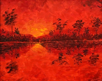 Archival Giclée Open edition print on 100% cotton rag of a Sunset over the Okavango river by Nkolika Anyabolu. Signed and dated by artist.