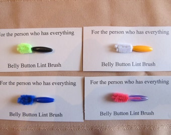 4 belly button lint brushes - for the person who has everything