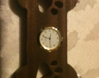 Wooden dog bone shaped clock