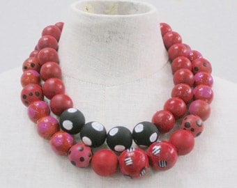 Large wood beads, hand painted, double strand, black and red and white and fushia.