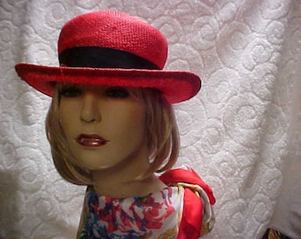 SALE.  Red light weight straw like derby hat with black grosgrain ribbon band- fits 22 inches