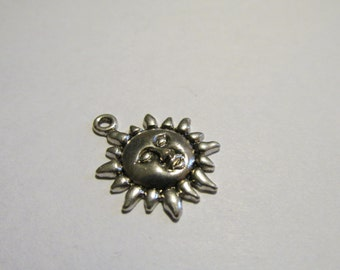 2 small sun charms, Antique Silver Tibetan style.  (2 cm)
