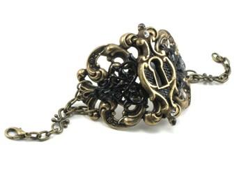 SALE 50% OFF Steampunk Gothic Lolita Bracelet - Gatekeeper Cuff - Hand Painted Keyhole over Brass Filigree - By Ghostlove