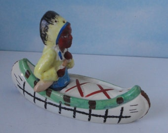 Japan Indian Chief and Canoe Ceramic Salt and Pepper Shakers.