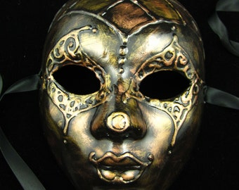 Riveted Mask, Full faced harlequin style mask with various metal gildings and 3D raised jester/clown design