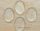 50 pcs 18x25mm GLASS DOME OVAL Cabs Tiles Cabochons . Crystal Clear and Beautiful