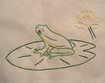 Tree frog on lily pad tea towel- hand embroidered
