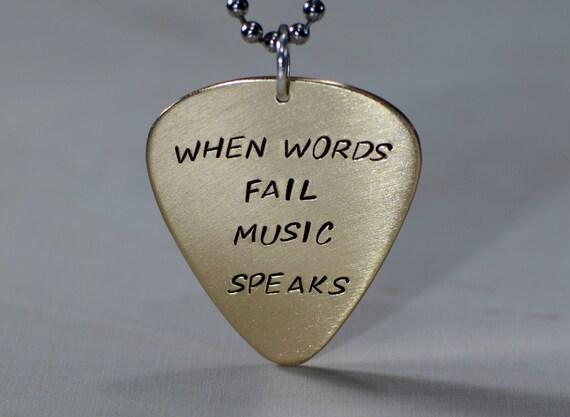 When words fail music speaks bronze guitar pick pendant
