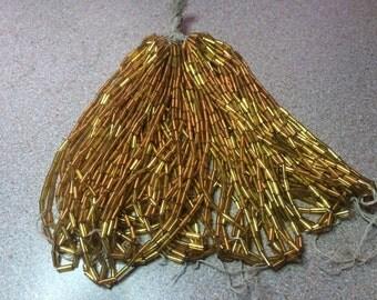 Vintage tube bead hank Czech glass Gold  lined Hex cut   hank
