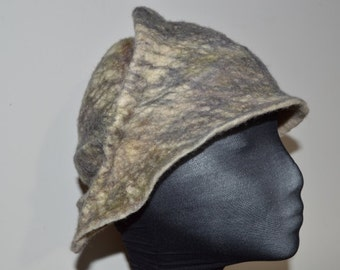 This wet felted merino wool hat fits a 21 inch measurment and has hand stitched ridges to maintain shape