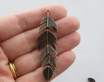 2 Feather pendants antique copper tone CC7