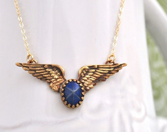 STAR Is MY GUIDANCE, wing charm necklace with  with vintage blue starlit glass cab, gold filled chain