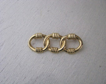 Vintage gold tone intertwined triple circle brooch pin