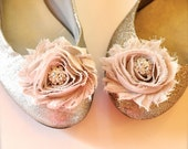 Shoe clips with blossoms and rhinestone centers.  70 colors available.