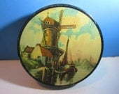 vintage anna belle chocolates candy tin with lid, wind mill with fishing boat & cottage