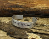 Keep Moving Forward, hand hammered, hand stamped, 1/2 inch, aluminum cuff bracelet