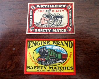 2 antique Swedish matchbox papers - unused, labels, 1900s, train, cannon