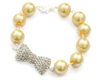 Pinup Yellow Pearl and Rhinestone Bow Bracelet, Womens vintage inspired jewelry