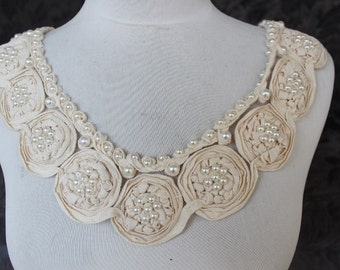 Cute embroidered   and beaded   flower  applique   ivory    color