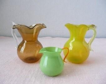 Set of Three Hand Blown Miniature Glass Pitchers