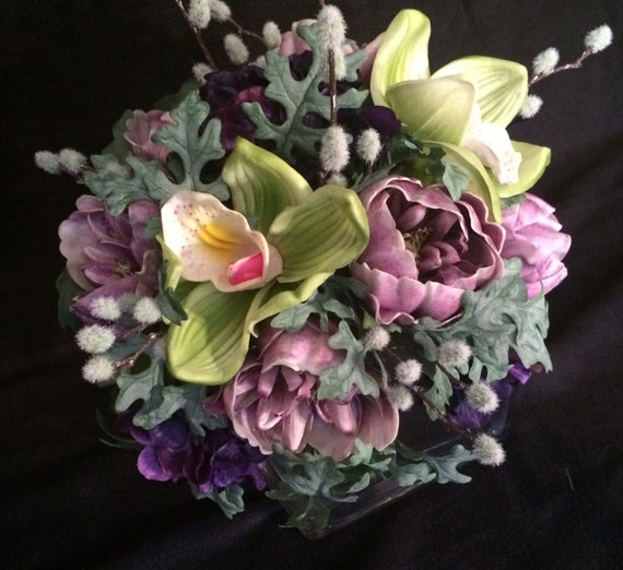 Soft colors bouquet. Real touch lime orchids, lavender peonies, dusty miller greens. You choose the color of ribbon wrap.