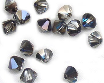 Swarovski Crystal Beads Bermuda Blue Bicones 4mm (24)
