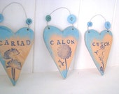 Welsh language hearts, Cwtch, Calon, Cariad aqua ceramic hanging heart. Made in Wales.