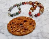 Protect and Nurture  -  Natural Brown and Green Stone and Crystal Chakra Balancing Necklace with Hand Carved Jasper Ram Pendant