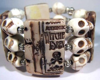 Skull and Bat OOAK Small memory wire stamped polymer clay bracelet Covington creations original art