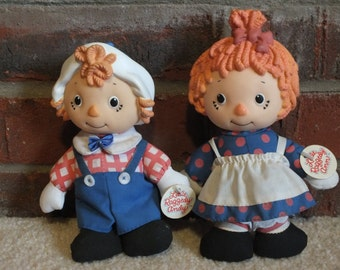 A Pair of Vintage Little Raggedy Ann and Andy 1991 Macmillan Dolls with orange hair.  Soft bodies with hard plastic heads, original tags