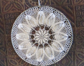 12 inch Delicate eye-catching crochet window or wall hanging with a small crystal