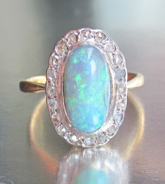 antique 1 carat black opal and halo ring 18k