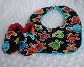 Monster Print Flannel Booties and Bib Set - Baby Shower Gift - Newborn Size Soft Soled Shoes with Terry Cloth backed Adjustable Bib