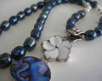 Freshwater pearl, mother of pearl, and abalone necklace.