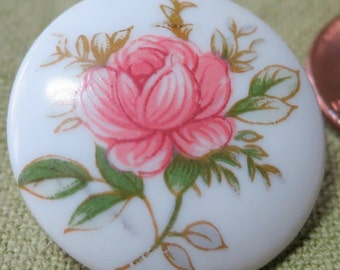 """Porcelain button with stemmed  pink painted rose with greenery motive. 1"""" across, slight dome. Lovely ornate  back, loop. CLVAM14.10-4.10-10"""
