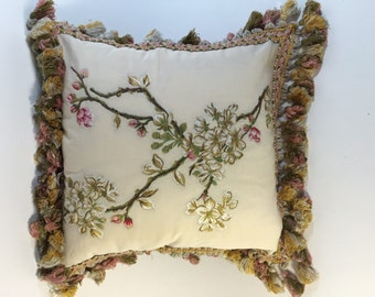 Silk embroidery of cherry tree branch on silky cotton.