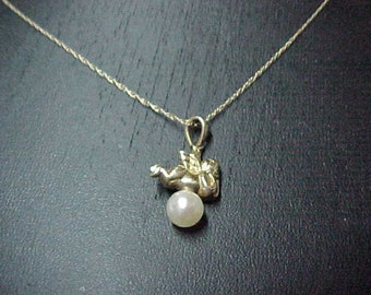 "Vintage Angel, 14K Yellow Gold, 3/8"" x 1/4"", Resting on 6mm Cultured Pearl, 18"" 14k Chain"