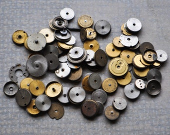 Mix of Antique watch parts,cogs,wheels.
