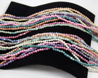 Reduced...Vintage Hand Carved Mulit Colored Shell Beads in 12 Strands Necklace circa 1980s