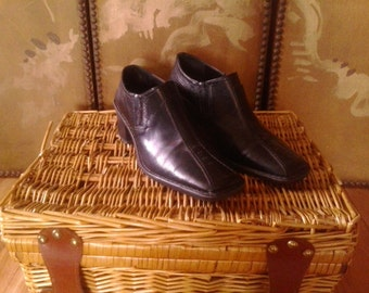 Black leather slip on shoes by Bata, Italy