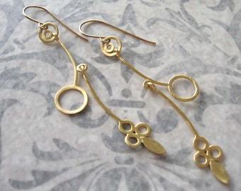 Long gold earrings , Dangling minimalist earrings , Delicate mobile leaf  earrings , Handmade by Adi Yesod