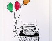 Typewriter with balloons
